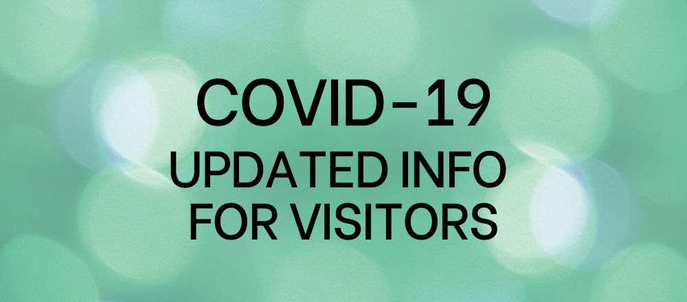 Green background with the words covid-19 updated info for visitors