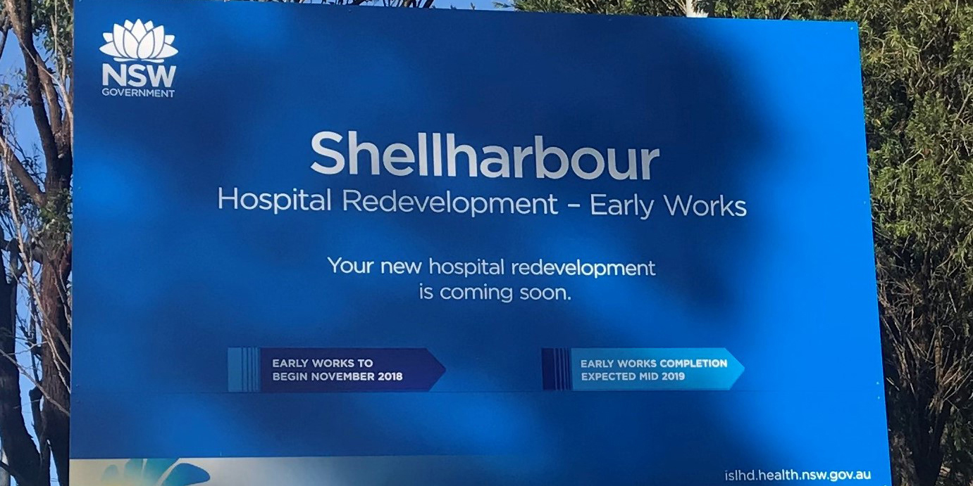 "Sign that says ""Shellharbour Hospital Redevelopment - early works. Your new hospital is coming soon."""