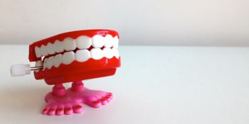 Wind up denture toy on white table