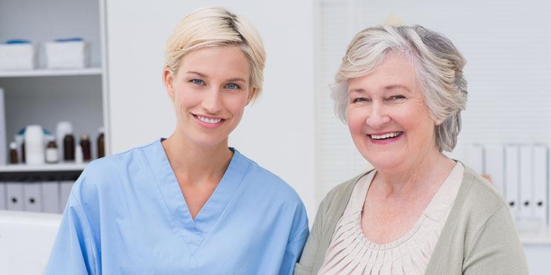 Image of a nurse and patient smiling